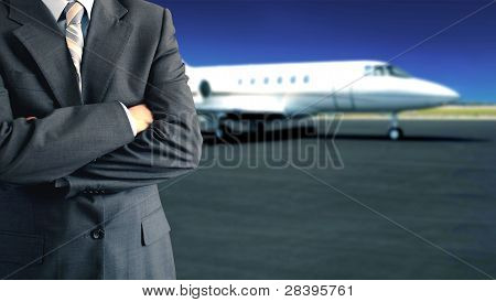 Businessman In Front Of Private Jet