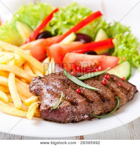 Grilled beefsteak with french fries