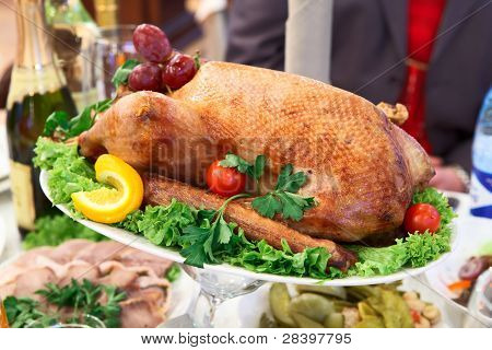 Roast Turkey In A Dish On The Dinner Table