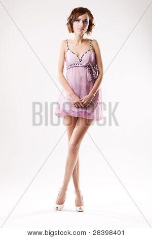 Beautiful woman in pink dress, studio portrait