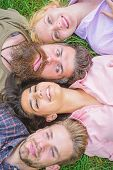 Friendship Through Whole Life. Company Friends Lay Grass Top View. Blonde Or Brutal Hipster Friends  poster