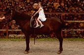 Girls Ride On Horse On Summer Day. Children Sit In Rider Saddle On Animal Back. Equine Therapy, Recr poster