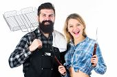 Family Weekend. Couple In Love Hold Cooking Utensils For Barbecue. Tools For Roasting Meat Outdoors. poster