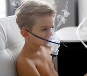 Sick Boy In Nebulizer Mask Making Inhalation, Respiratory Procedure By Pneumonia Or Cough For Child, poster