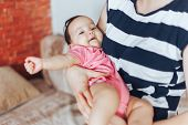 Mother Hold Little Baby Girl On Hands Baby Lookibg At Camera poster