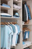 Stylish Clothes And Home Stuff In Large Wardrobe Closet poster