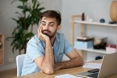 Tired Worker Wasting Time At Workplace Distracted From Boring Job poster