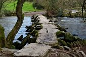 Photograph Of The Clapper  Bridge At Tarr Steps In Devon poster