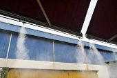 Water Mist Cooling System Lowers Ambient Temperature At Restaurant poster