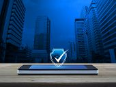 Security Shield With Check Mark Icon On Modern Smart Mobile Phone Screen On Wooden Table Over Office poster