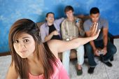image of foursome  - Beautiful young Hispanic woman annoyed with men playing video games - JPG