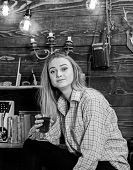 Girl In Casual Outfit Sits In Wooden Vintage Interior. Relax Concept. Girl Tomboy Relax With Glass W poster