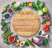 healthy food selection with fruits, vegetables, seeds, super foods, cereals and the wooden board in  poster