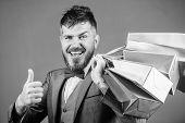 Man Bearded Elegant Businessman Carry Shopping Bags On Grey Background. Make Shopping More Joyful. E poster