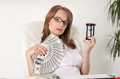 Businesswoman With Hourglass And Money