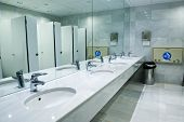 stock photo of pee  - Public empty restroom with washstands - JPG