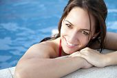Close up portrait of a beautiful happy woman in swimming pool