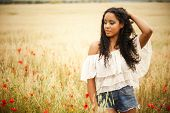 stock photo of mixed race  - Young african woman outdoors - JPG