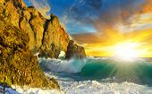 Picturesque Seascape With Waves And Rocks At Sunrise.background With Rising Sun Above Summer Sea. poster