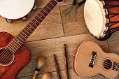Ethnic Musical Instruments Set: Tambourine, Wooden Drum, Brushes, Wooden Sticks, Maracas And Guitars poster