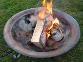 Fire Pit With Burning Logs