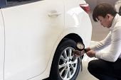 Asian Man Car Inspection Change Wheel Rubber Tires Car.close Up Hand Holding Car Screw Driver For Ca poster