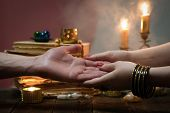 Palmistry Concept. Fortune Teller Reading Future On The Hand On A Magic Table Background. Future Rea poster