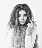 Girl Fur Coat Posing With Hairstyle On White Background. Hair Care Concept. Prevent Winter Hair Dama poster