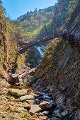 Footbridge on hiking trail with hikers toursits at Biryong Falls Waterfall in Seoraksan National Par poster