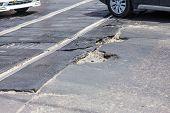 Very Bad Quality Road With Potholes. Hole In Asphalt, Bad Asphalt. Pit, Unsafe, Hole Road. Transport poster