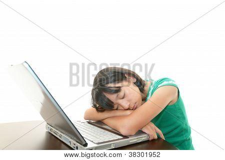 Girl using laptop being tired