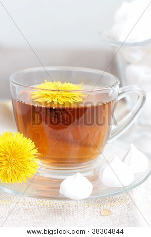 tea in glass cup and flowers
