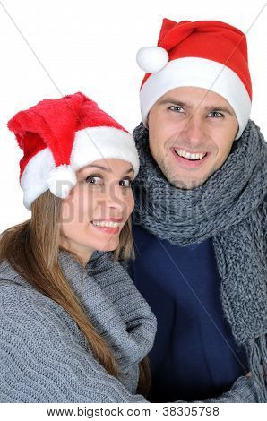 Smiling couple in Santa Claus Hats