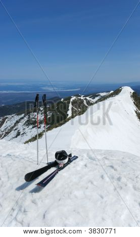 A Pair Of Skis On The Top Of The Mountain