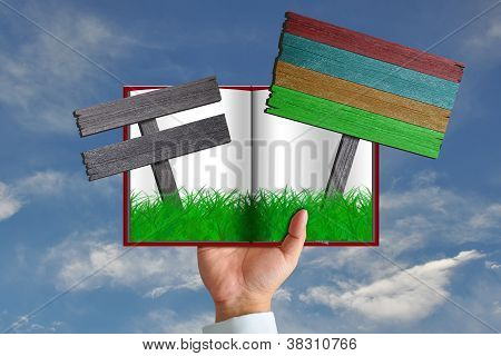Green Grass In Book And Wooden Sign