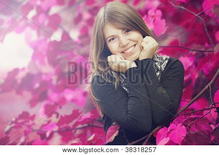 Beautiful Girl At Autumn Park. Leafs In Pink Color.