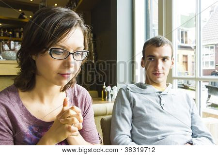 Young Woman Listening To Her Sweetheart In A Cafe