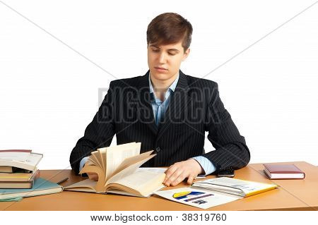 cute man reading a book at table