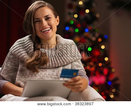 Smiling Woman With Tablet Pc And Credit Card In Front Of Christm