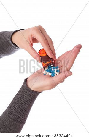 Pills In Woman Hand