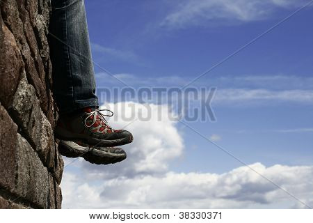 man sits on the wall