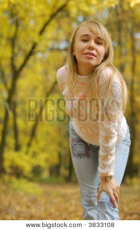 Girl On A Background Autumn Forest