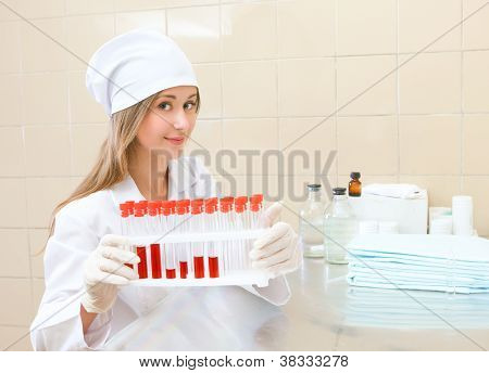 medical worker with tubes blood tests