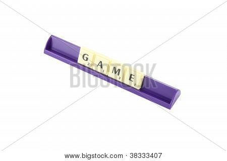 Game wording in queue scrabble on white background.