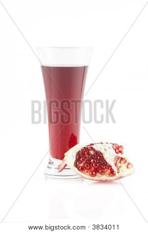 Glass Of Pomegranate Juice And The Broken Pomegranate. Isolated On White Background.