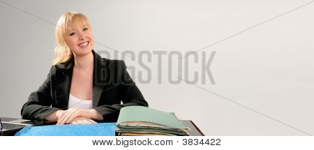 Cute Blond Business Woman At Desk