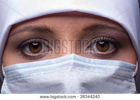Woman Wearing Surgical Cap And Mask