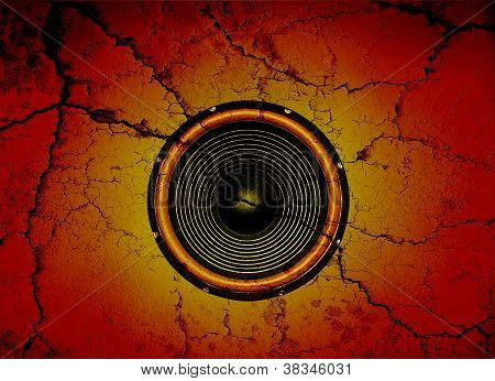 Speaker On A Cracked Wall Background