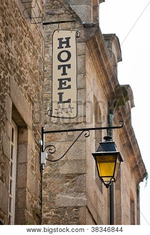 Hotel Sign On Old Stone Building