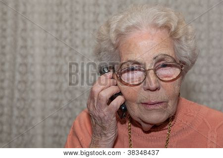 An Old Woman With A Mobile Phone